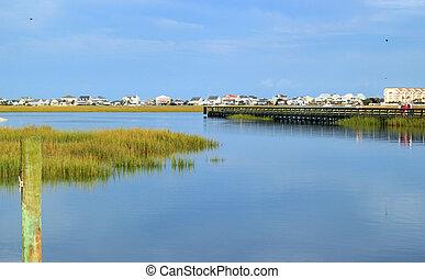 Boardwalk on the inlet - Boardwalk through the marsh in ...