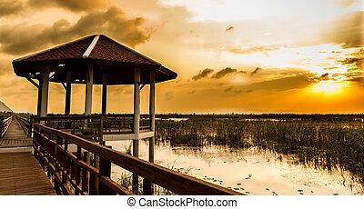 Boardwalk on the lake at sunset, Sam Roi Yod National Park, Prachuap Khiri Khan, Thailand