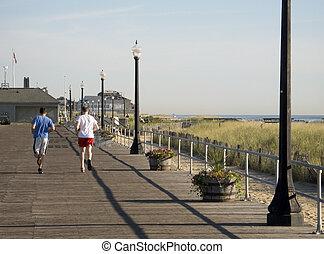 Some runners training on the boardwalk in Ocean Grove NJ.