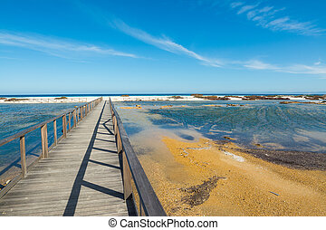 boardwalk to the beach in Stintino