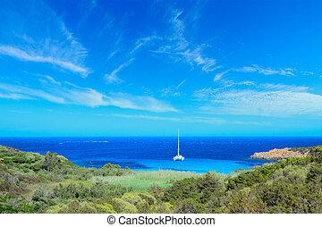 boat alone in Costa Smeralda shoreline, Italy