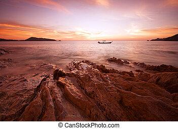 boat alone in sea twilight phuket thailand