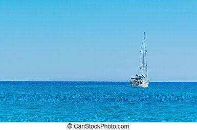 Boat alone in the blue sea