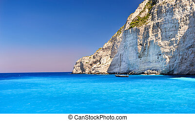 Boat anchored on Navagio beach (also known as shipwreck...