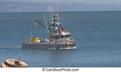 Boat and Buoy - A working boat, (fishing and/or cargo) moves...