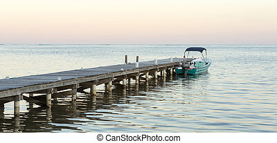 Boat And Jetty At Sunrise