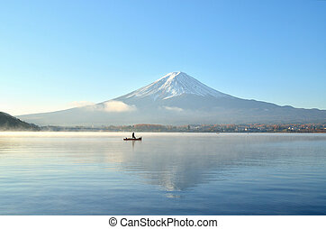 Boat and mount fuji in the morning at kawaguchiko lake japan