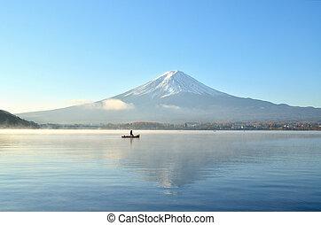 Boat and mount fuji in the morning at kawaguchiko lake japan