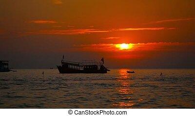 Boat at Anchor and Jetski at Sunset in Sihanoukville, Cambodia