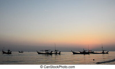 Boat at beach and wave in evening