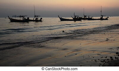 Boat at beach in evening