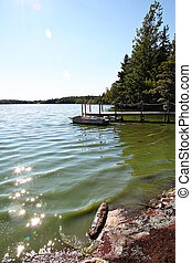 Boat at dock in lake