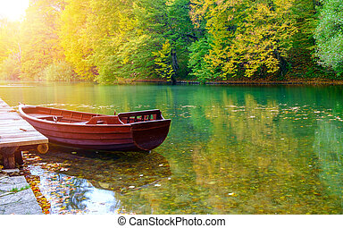 Boat at Plitvice lakes, autumn in Croatia