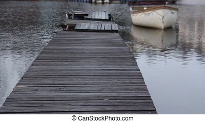 boat at the old wooden pier - empty old wooden pier into the...
