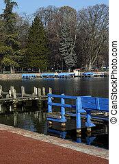 Boat blue pontoons on Annecy lake