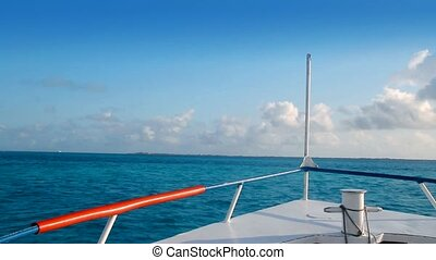 boat bow blue Caribbean sea Cancun to Isla Mujeres Mexico