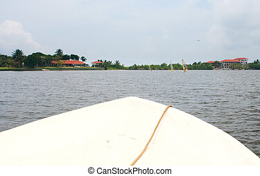 Boat Bow on tropical river - Boat bow on tropical river with...