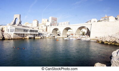 boat, bridge, bright, coast, cruise, famous, france, french connection, harbour, harbourside, journey, landmark, location, marina, marseille, mediterranean, ocean, port, quaint, ripples, sail, sea, ship, summer, sunshine, tourist, transport, trip, vacation, vallon des auffes, voyage, water, yacht