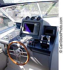 boat cockpit - cockpi inside a boat with a wood wheel