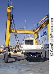 boat crane travelift lifting motorboat