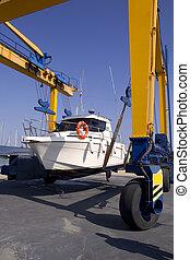 boat crane travelift lifting motorboat