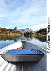 Boat cruising a mountain lake. Switzerland