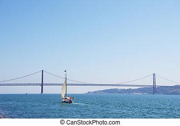 boat cruising on the river Tejo near Lisbon Portugal
