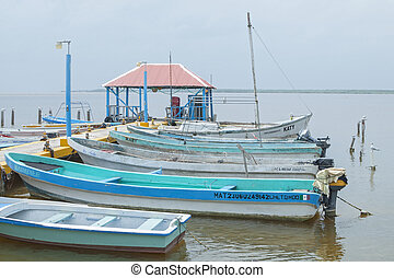 Boat dock in Chetumal - Small colorful motorboats docked in...