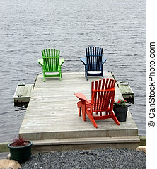 Boat Dock with Adirondack Chairs