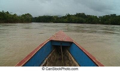Boat Driving Down River 2 - Steady, medium close up shot...