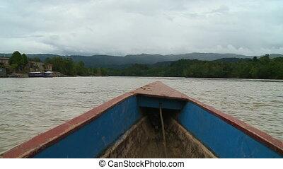 Boat Driving Down River - Steady, medium close up shot...