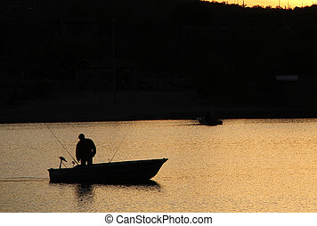 Boat Fisher - Single fisherman on a quiet
