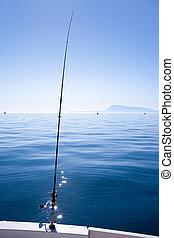 boat fishing rod in mediterranean blue sea