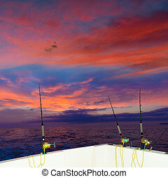 boat fishing trolling at sunset with rods and reels