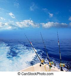 boat fishing trolling in deep blue ocean offshore in...