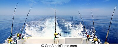 boat fishing trolling panoramic rod and reels blue sea wake