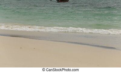 boat float in the azure waters off the coast of the island...