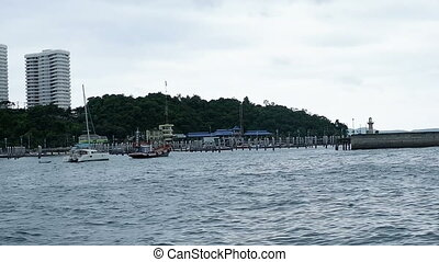 boat floating in the calm water sea view at Pattaya beach Thailand.footage video