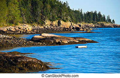 Acadia N. Park - boat floating near the rocks at Acadia N. ...