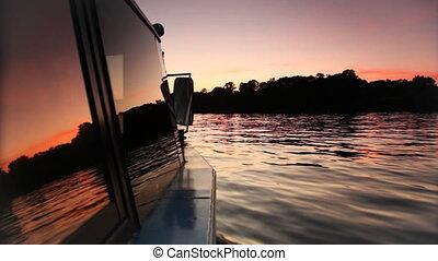 Boat floating on river lit night sky - boat floating on...