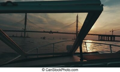 Boat floating to summer beautiful sunset. Bridge. Nature....