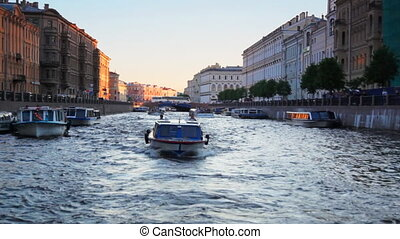 Boat floats on river channel to St. Petersburg - boat floats...