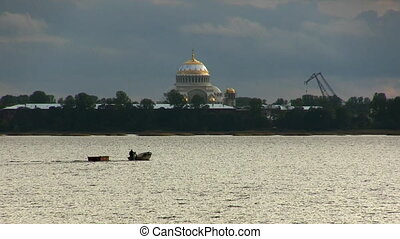 boat floats on the background of the Naval Cathedral of St....