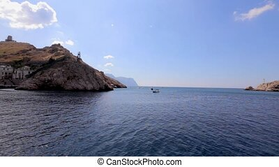 Boat floats on the Balaklava bay in sunny weather