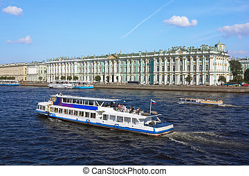 boat floats on the River Neva by Hermitage on a sunny summer day