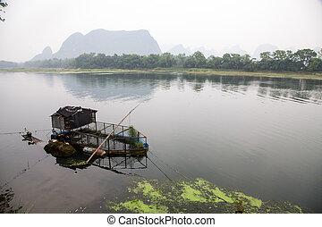 Boat for fishermen in the Li river, China
