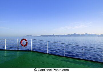 Boat green deck with Ibiza island mountains