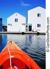 Boat house in Tacoma, WA and orange kayak.