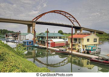 Boat Houses under the Bridge