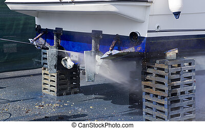 Boat hull cleaning water pressure washer barnacles antifouling and seaweed